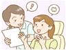 歯科スタッフから説明を受ける患者さま